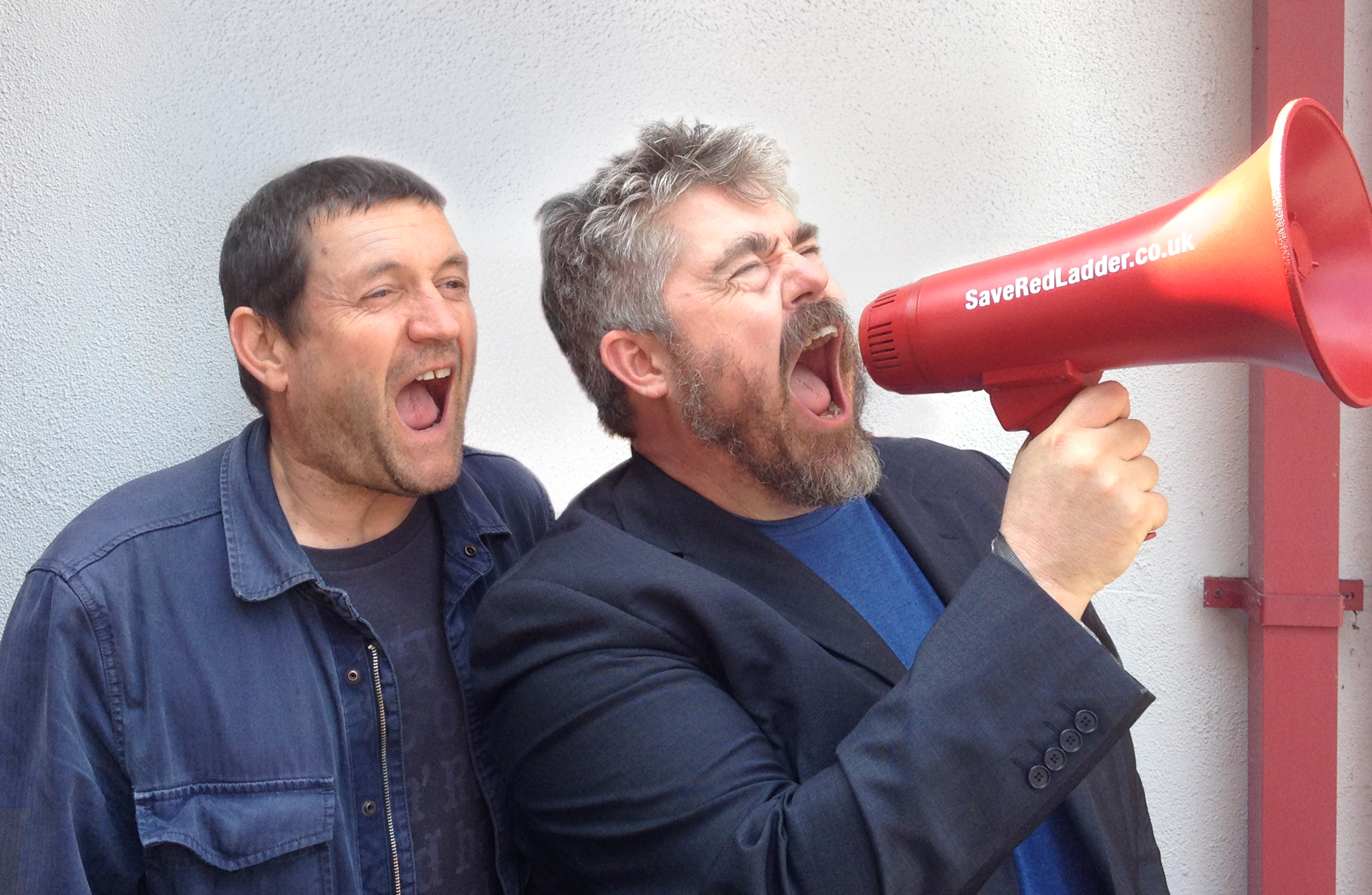 Phill Jupitus and Paul Heaton get behind the red Save Red Ladder megaphone!
